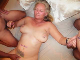 playing with two lovely cocks.