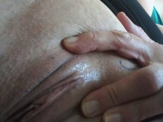 SouthEastSally showing her shiny silky smooth shaved slit.