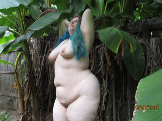 My lovely wife showing off her voluptuous contours as she poses naked in the banana trees. See anything you'd like to get your hands on?