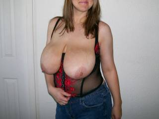 Now that's what I call blessed with Natural tits my mouth just salivating just thinking of them, not mentioning the stiff cock that I have in my jeans trying to get out for some air! Thank's for the photo!