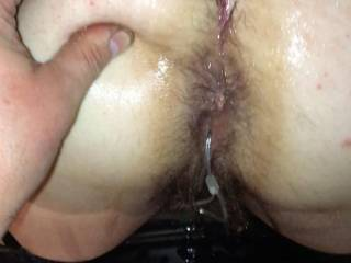 Getting my hairy pussy and butt covered in oil ready for a good hard fucking 
