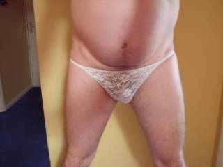 Seeing you in those panties gives me a hard on... which I am stroking right now.