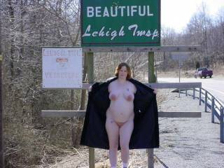 Here is my wife when she was pregnant and still flashing.  She's posing again with some of our local signage