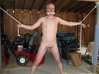 Bound in the garage with gag and full tie up.