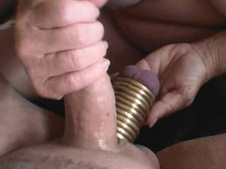Third of 5 pictures showing me giving boyfriend a hand job and him cumming. Notice the 11 rings on his balls, now that is a handful of balls and steel. He wants to fuck me with those steel balls, should I let him? Would you watch that video?