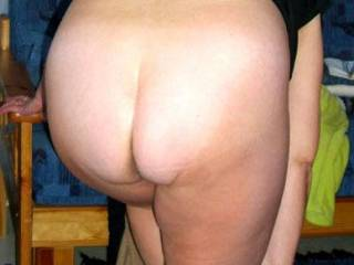 i love the view of a mature woman from behind. sidle up and fondle their tits and before you know it she is holding on to the arms of that chair and your in. take your pick of her holes. great.