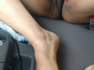 Mature Ebony woman waiting for some oral and a foot massage