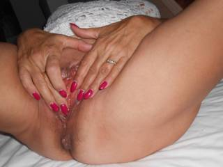 Playing with her clit in front of me