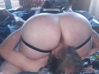 Dressed her in a leather harness spread her legs and voraciously tongued her great ass and pussy deep.while my swollen cock in her mouth stifled her moans of  pleasure