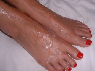 Lots of guys said they loved Mrs Oz's feet so here are a couple of pics of them with my cum coating them