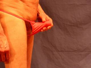 Testing out a pink thong; I am not sure that the colour really works on me.