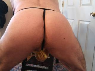 I just cannot get enough of my man's ass!! Notice that cock below? Guess what happened to that hard rock of his? Mmm...
