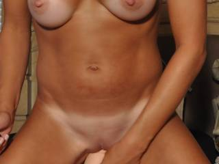 It looks so good sliding in your sexy pussy!  I would love to worm you up for it next time.
