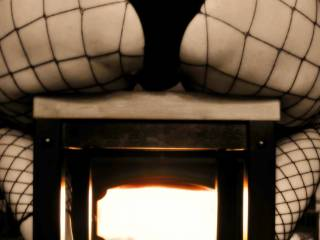 staying warm in my fishnet lingerie in front of the fireplace