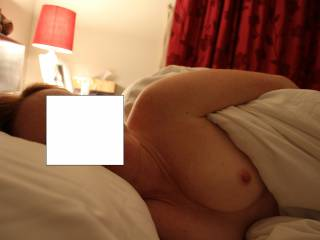 Nude redhead wife on bed