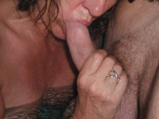 Sucking our swinger friends cock in the spa at home, when he came around for a threesome.