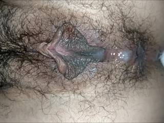 I dumped a big load of semen inside her pussy. As she pushes it out it runs down onto her asshole.