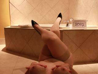I'd gladly get the bath water @ the temp you want and slip off your heels. You feet are bound to feel better once you're out of those heels..with your tits..that, aroused.