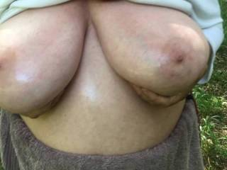 2 of 4 - now oiled, my friend displays her lovely big tits in a nice way - pulling them wide apart, then close together, apart, together, and so on ...