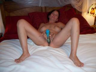 Kathy begins to penetrate her tight opening with a thick, 10 inch cock shaped vibrator. This petite gal loves having her pussy stretched wide when she's fucking a hard cock. Tell her if you think you can stretch her pussy wide with your manhood.