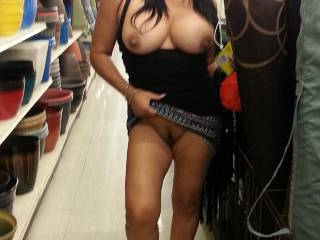 Wow she has one sexy pussy i would pretend like im getting something from the bottom shelf and have her close tk me and ill be eating that pussy really good
