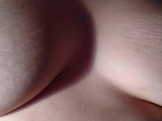 Close up of my tits while getting fucked. Would they look better with a load all over them?