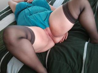 A sexy bbw who likes to suck a cock lovingly and is wearing lingerie and stockings mmmm...That would be my pleasure in pleasing us ;)