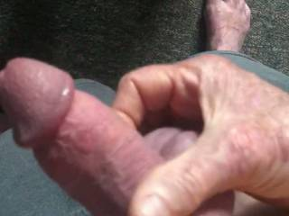 Stroking cock for a friend to watch.