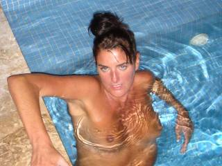 Ummm, what a hot naked lady.  If I joined you in that pool we wouldn't be doing much swimming. Do you have any underwater oral skills. LOL  G