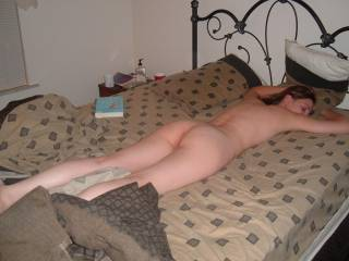What a perfectly laid out sexxxy body for mounting as she lays in that very position!!! I'd love to cum all over that ass too!!!!
