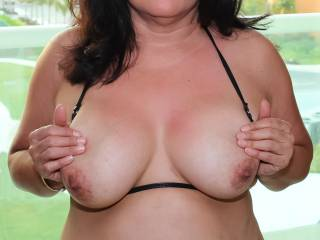 Pic 2 of 2:  Tiny black bikini top pulled to the side exposing my tits and nipples!