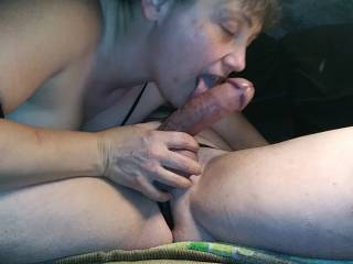 With my cock firmly in her grasp she gives it the tongue lashing that it deserves.
