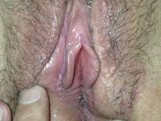 My ex girlfriend's wet pussy. Best pussy I've ever had! She's never been with another woman, but wants to try. What do you ladies think, would you like to eat this sweet pussy?!