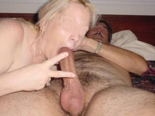 gettin the 9 sucked good at a swingers party moments later covered her face in white stuff.  what do you think?
