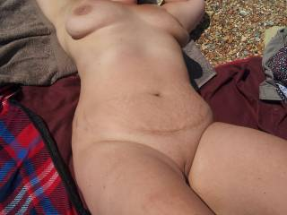at the naked beach enjoying the sun and stares!