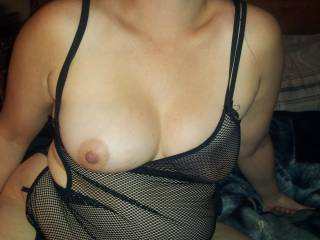 slowly she peels off her see through top