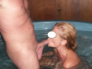 Sucking Mr Oz's lovely cock in the new spa house at home.  Check out his sexy big low hanging balls with the warm water. He has got a hot body for his age still. What do you think ladies?