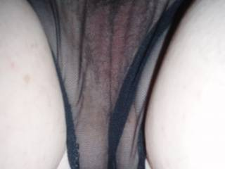 your pussy looks so sweet and horny in those black see thru panties. Love to part your lips with my tongue mm