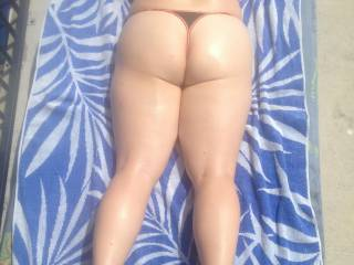 I hope you don't mind me using some extra sun cream for lube and humping your thighs and sexy ass with my thick, hard cock until it adds some cream of its own.