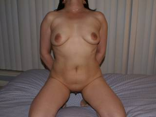 Very sexy! Tits look like a lot of fun and would love you to hover over my face like this while I tongue bath that sweet pussy till you explode all over my face!