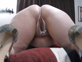 Wife showing off her great ass before Hubby slides his hard, thick cock inside that wonderful pussy.