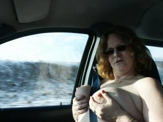 My wife on our last road trip.  She had a blast flashing truckers and putting on a show for them.
