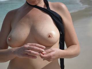 My wife got a little horny on the beach and agreed to strip!  This is the first time she has ever done this, but she didn't think anyone else would want to see her tits!  Let us know what you think! If you have good comments, we have plenty more photos an