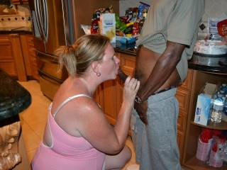 wife giving buddy blowjob in the kitchen while on vacation