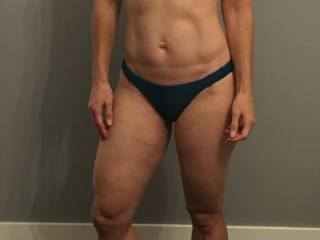 Here she is in some new bikini bottoms. She can't wait for the summer to show off her sexy ass at the beach. Do you like this one?
