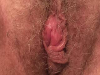 She was quick to drag me to the bed after our long car ride. I was teasing her about feeling frisky but she didn't give me any indication of hope during the ride. This swollen clit told me it worked!