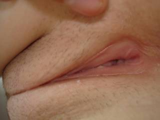 a very close up shot of my girls very tight pussy