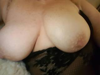 Another picture of my wifes fantastic tits.  They love to be sucked.