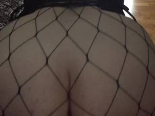 Mabel's is being used as a bar for shots, struggling to hold still with Merv stretching her pussy and pushing against the butt plug.  We down the shots! Do you think the fishnet body stocking and tight corset show off Mabel's fine round arse