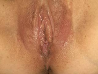 This was after eating that sweet pussy to orgasm with the labia spreaders on.  She said it was a very intense orgasm and you can see she\'s dripping wet!  Tasted so good and got her juices all over my face!